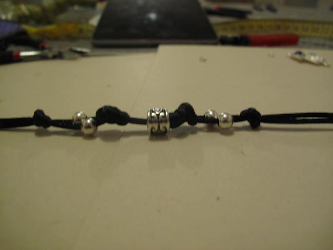 8-hacer-nudos-costado-perlas